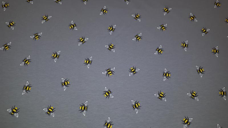 Grijs tricot stof met bijtjes