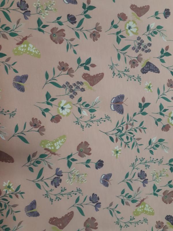 Roze Tricot stof  met bloemen en vlinders