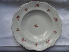Diepe borden met grote en kleine roos