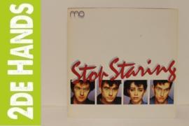 Mo – Stop Staring (LP) D70