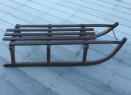 Bruine houten slee