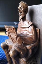 Set boekensteunen met lezende figuur
