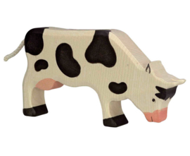 Holztiger Houten koe grazend zwart wit