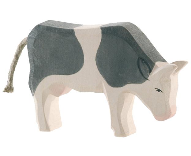 Ostheimer Houten Koe zwart gevlekt etend