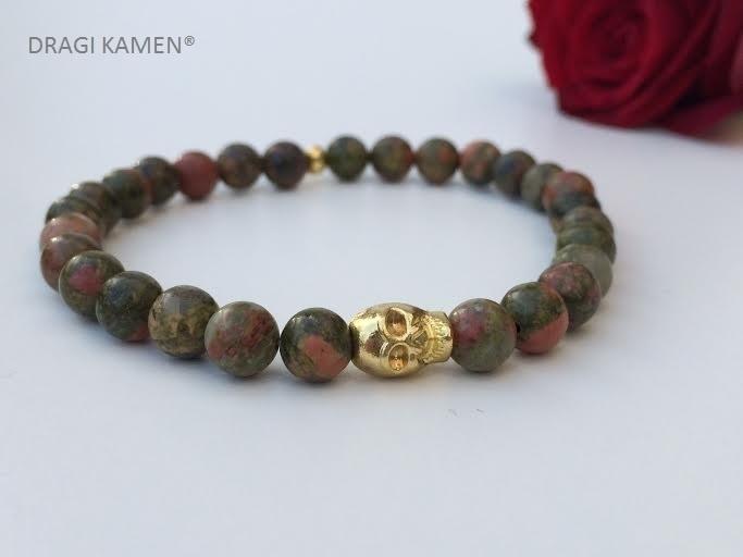 Armband met Unakiet 6 mm ronde kralen en goud kleurige skull