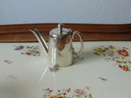 Antique silver plated hotel tea jug.