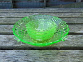 Uranium glass bowl set with three small bowls
