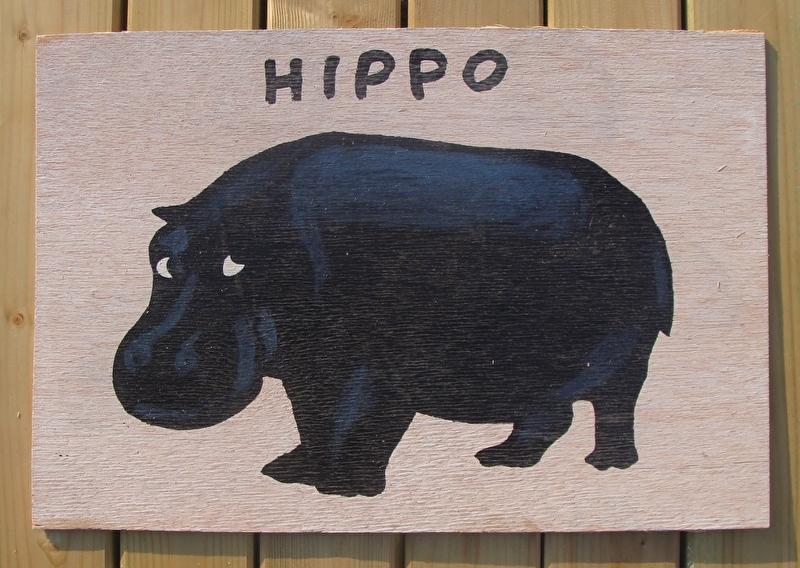 Schilderijtje Hippo, zwart/wit, op hardboard 30 x 45 cm