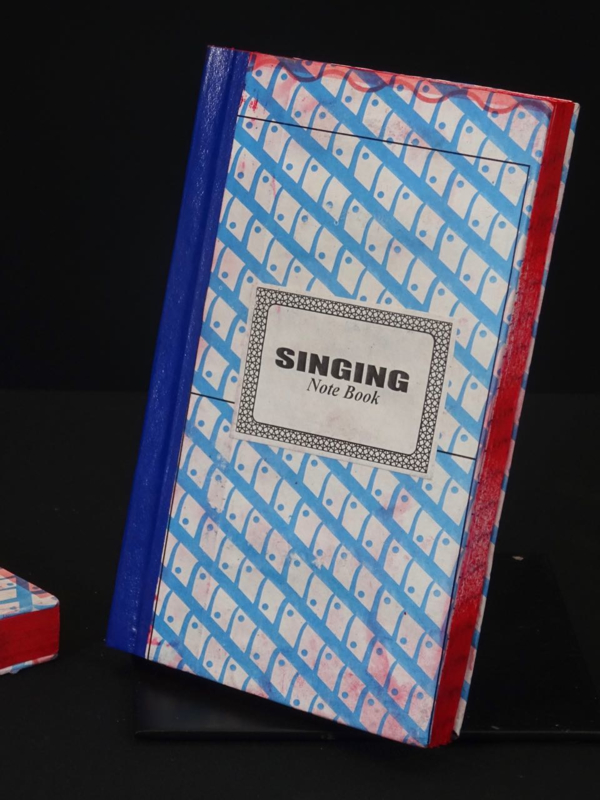 4 African singing notebook, blauw