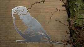 Geluksvogel : silhouet van een Uil