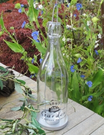 Theelichthouder glazen fles met Franse tekst