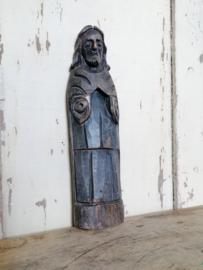 Oud houten beeldje, ornament.