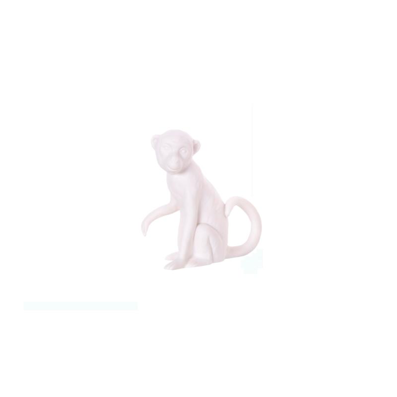 Aapje Mowgli groot - zittend poot omhoog