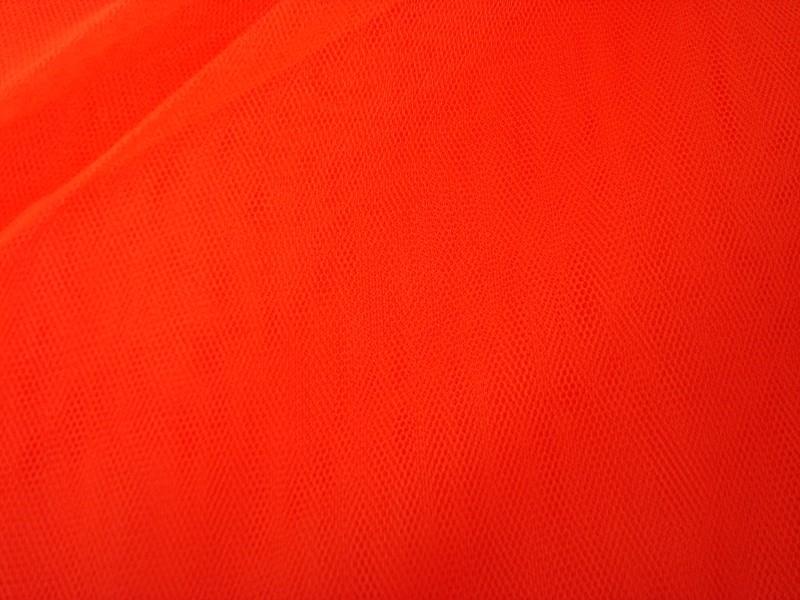 Tule oranje 140 cm breed grootverpakking 40 meter 1,00 euro per meter ART T49