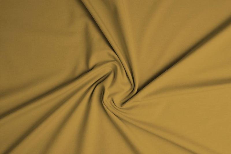 Tricot uni 155 cm breed kleur oker € 5,50 p/meter Art -082