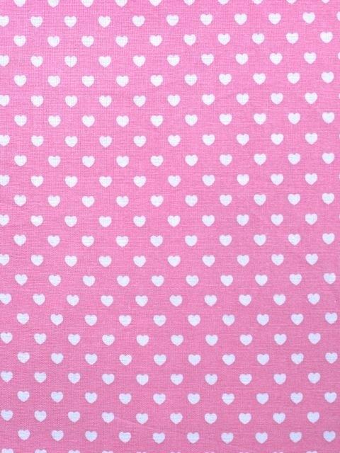 Roze stof met witte hartjes