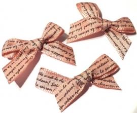 Stoffen strikje met tekst oud roze (1331984)