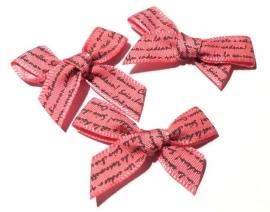 Stoffen strikje met tekst in de kleur roze (1331979)