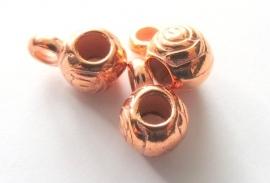 Metalen rose kleurige kraal bewerkt met hangeroog groot gat (13K000839)