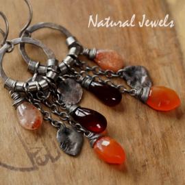 Robuuste zilveren oorbellen met oranje edelstenen