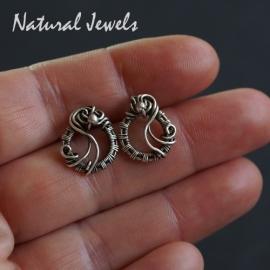 Zilveren handgemaakte oorstekers Curls