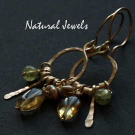 Gouden oorbellen met gele edelstenen