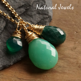 Luxe Gouden setje groene edelstenen
