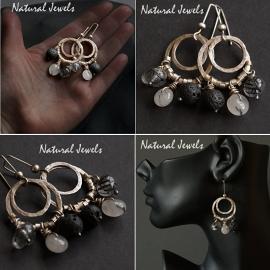 Handgemaakte zilveren oorbellen met Rutielkwarts Rondellen