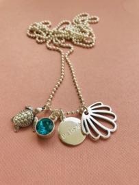 Be Lovely - Zilverkleurige ketting, met blauwe swarovski, schildpad en schelp