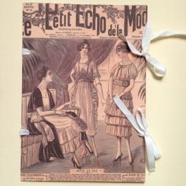 Handgemaakte bewaarmap met vintage kranten design