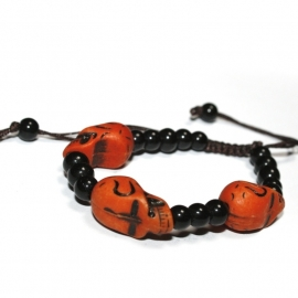 Black bracelet with Orange Skullies