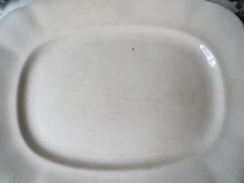 Beboterde schaal met geschulpte rand - serveerschaal