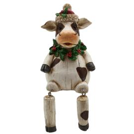 Kerst decoratie koe met bungelende beentjes