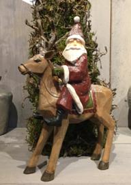 Kerstman op rendier