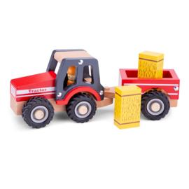 Tractor met aanhanger hooibalen rood