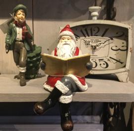 Kerstman met boek zittend 11*13*22