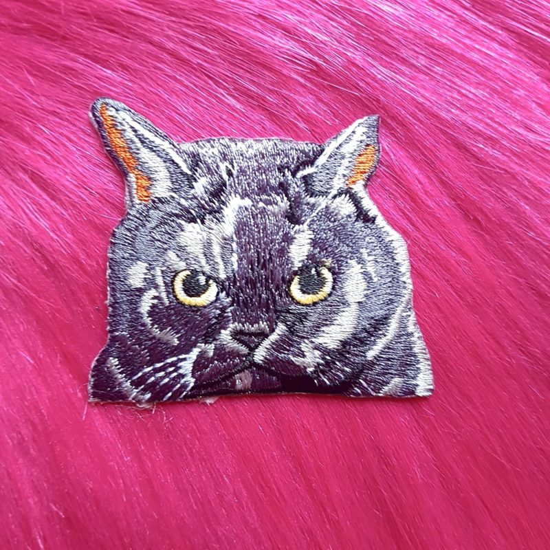 Grey cat badge