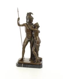 Een bronzen beeld van Venus en Mars