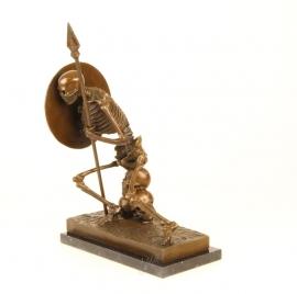 Bronzen beeld van een skelet als boekenhouder