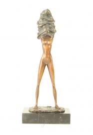 Bronzen beeld uitkledend