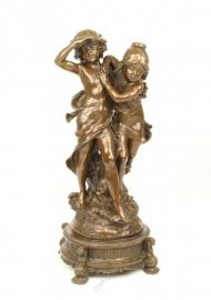 Bronzen ondeugende kinderen