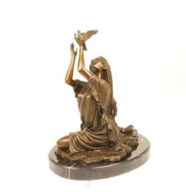 Bronzen beeld VRIJGEVEN VAN DE VOGEL