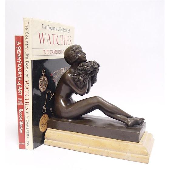 Bronzen erotische boekensteun