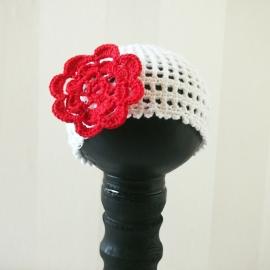 Bébienie met rode bloem