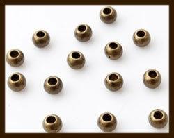 K017: Set van 2 Einddopjes van 5.5mm, rijggat 2.2mm: Bronskleur.