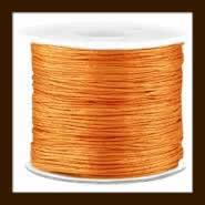 Rol Elastisch Nylondraad van 0.5mm, lengte 10m: Licht Bruin.