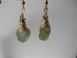 113 Green stone, wire wrapped. E20,-