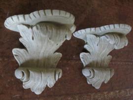 Oud stenen console wandornament