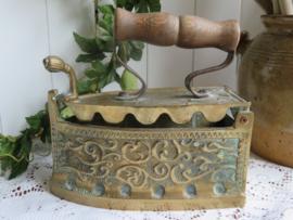 Antiek koperen strijkijzer strijkbout