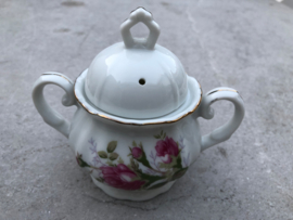 Suikerpot en melkkannetje roze bloem